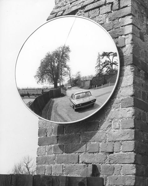 Large mirror on a wall at the roadside