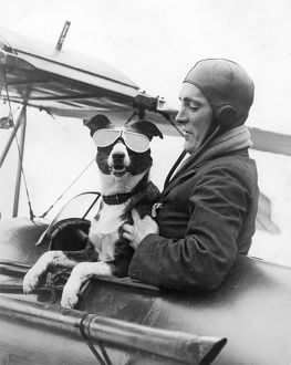 Mr Barnard and his dog Dan, who sometimes flew with him