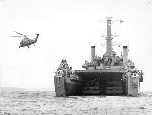 An RAF Westland Wessex flies over HMS Fearless (L10) at ?