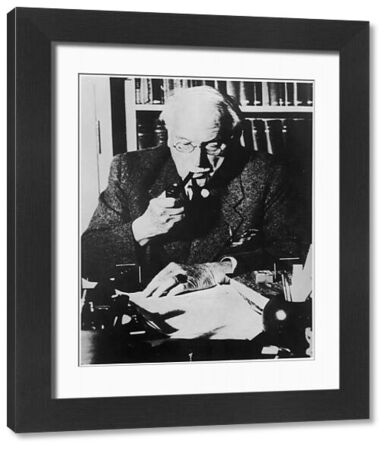 CARL GUSTAV JUNG Swiss psychologist at his desk