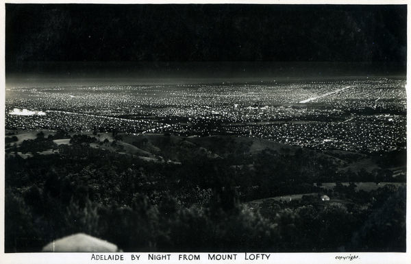 Adelaide, South Australia by Night - viewed from Mount Lofty. Date: circa 1930s