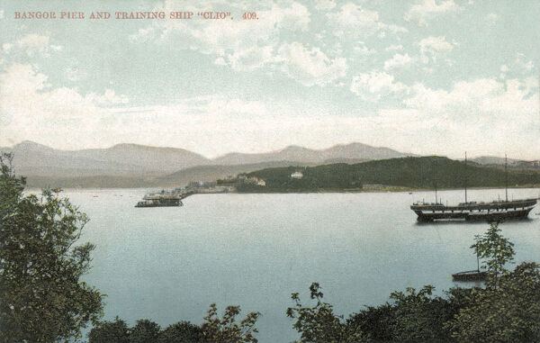 A view of Bangor Pier and the naval training ship 'Clio' which operated as a boys' industrial school from 1877 to 1920. Date: circa 1911
