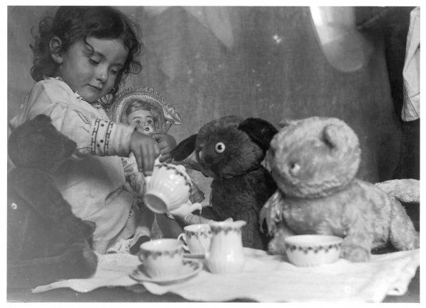 BEAR TEA PARTY 1915. A little girl hosts a tea party - three bears and a doll attend