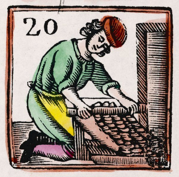 C17 BAKER/20. A baker rolls out his dough using an early type of rolling pin