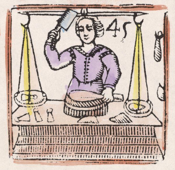 A shop keeper - butcher or poulterer - brandishes a cleaver as he slices a joint into cutlets or whatever