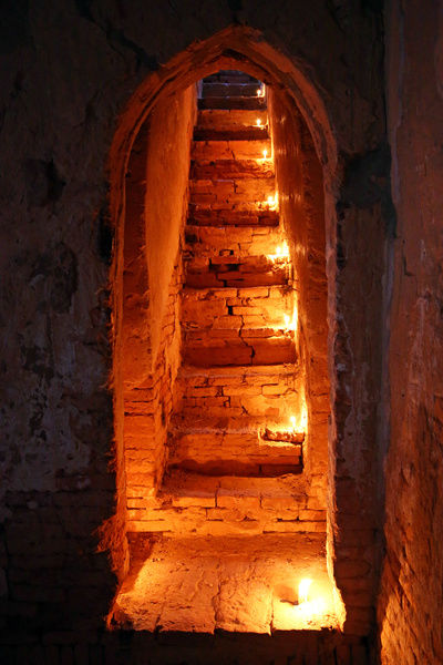 Candles on stairs, North Guni Temple, Bagan, Myanmar