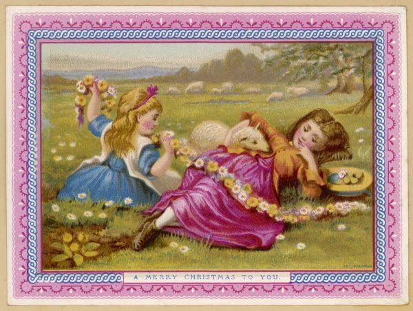 Two girls in a meadow - one making a daisy chain - neither thinking about Christmas