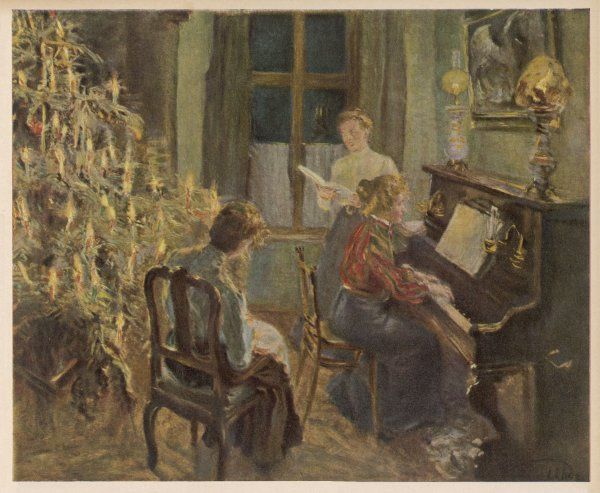 A German family sing carols by the Christmas tree