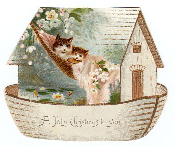 Two cats on a cutout Christmas card