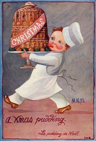 CHEF WITH PUDDING. A young chef carries in a decorated pudding