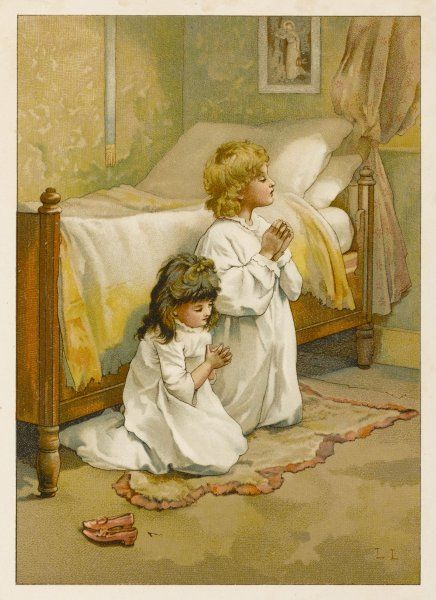 Two children kneeling to say their prayers before going to bed