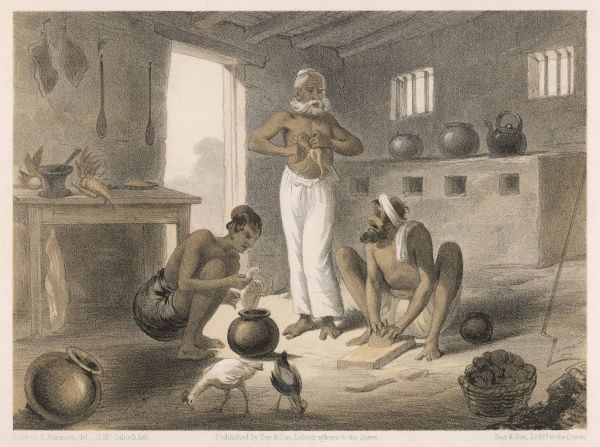 Natives preparing a meal : gutting chickens and rolling dough