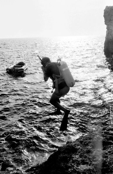 Diver jumping into the sea off the coast of Malta