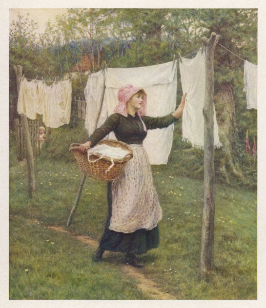 A woman in a pink bonnet check her washing line to see if her washing is dry