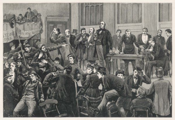 An election meeting - the audience giving the speaker a rough time