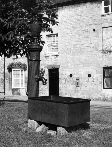 English Water Pump. An old iron village water pump at Chipping Campden