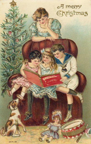 ENJOYING PRESENTS. Children with their presents share the delights of a picture book