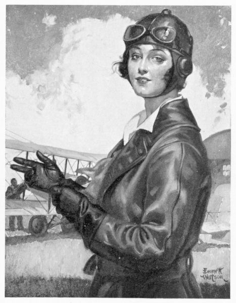 Pretty young aviatrix in a belted leather flight coat, leather gauntlets, helmet & goggles