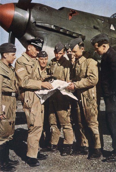 German pilots attend last briefing before a mission - aircraft in background is a Stuka