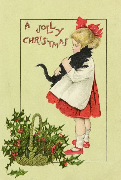 Girl, kitten and basket of holly