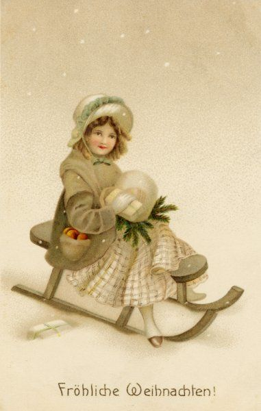 A girl in a muff sits on a toboggan holding some greenery and other things