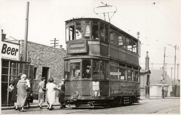 Glasgow Tram number 26 from Burnside to Scotstoun/Dalmuir via Bridgeton Cross - the stop at Springfield Road. The service was introduced on 15 August 1943. Date: circa 1944