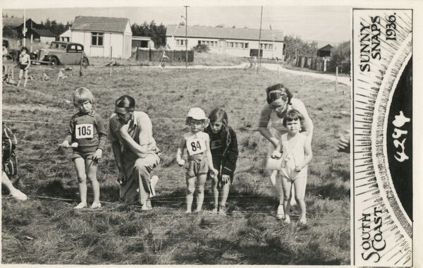 Sunny Snaps postcard showing a group of children lining-up on the starting line for a running race - South Coast holiday Camp resort. Date: 1936