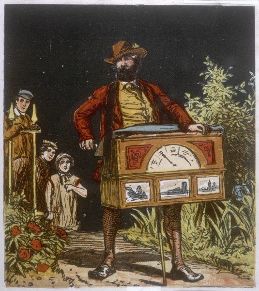 Victorian hurdy-gurdy man entertaining children