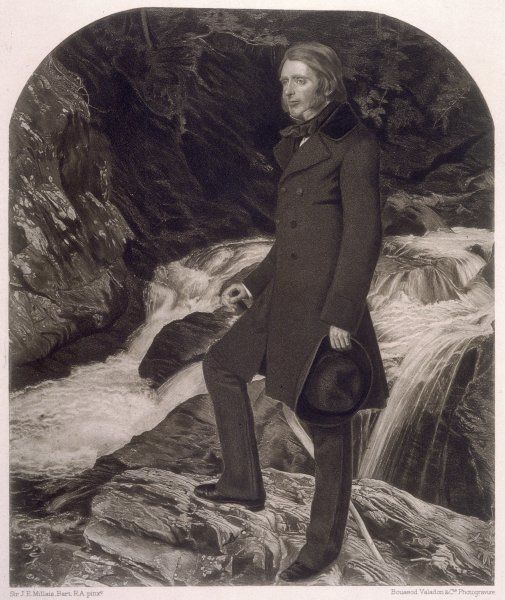 JOHN RUSKIN English art critic and writer stands on rocks beside a river