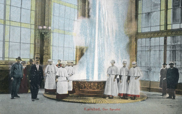 Karlovy Vary or Carlsbad (Karlsbad), in western Bohemia, Czech Republic - The Sprudel (Mineral Hot Water Spring Fountain or Geyser) and Spa Attendants in their waterproof uniforms! Date: circa 1911