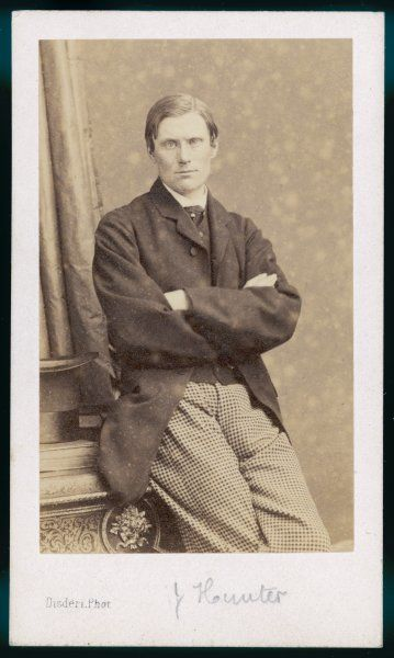A photograph of a gentleman - J Hunter - with his arms folded