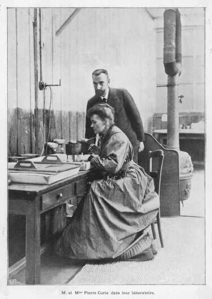 MARIE AND PIERRE CURIE in their laboratory, Paris