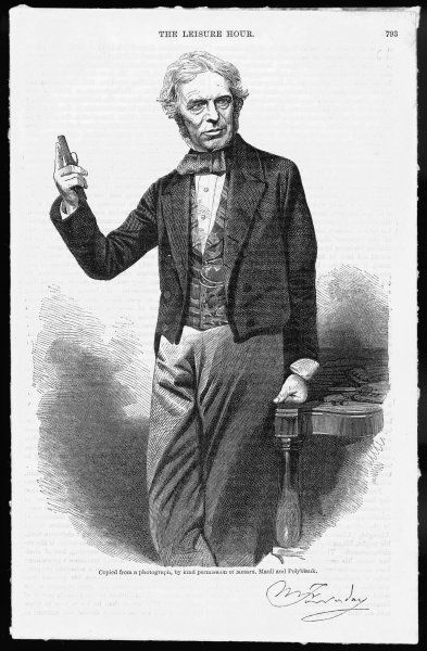 Michael Faraday (1791-1867), scientist, shown holding a glass bar of the type he used to show that magnetism can affect light