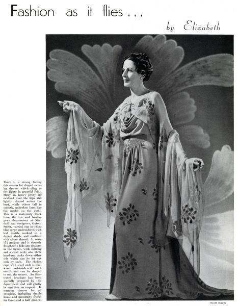 Model wearing a floral maternity evening gown 1937