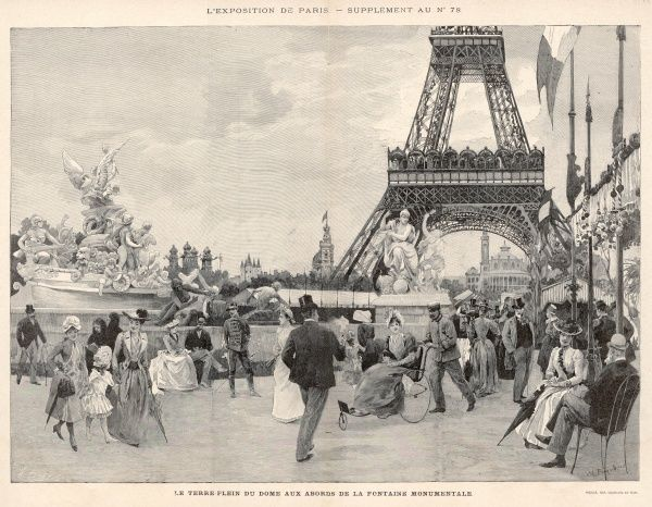 Visitors stroll in the fresh air beneath the Eiffel Tower in front of the monumental fountain