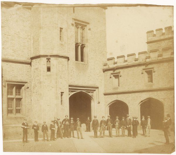 Scholars in front of one of the school buildings 3 of 4