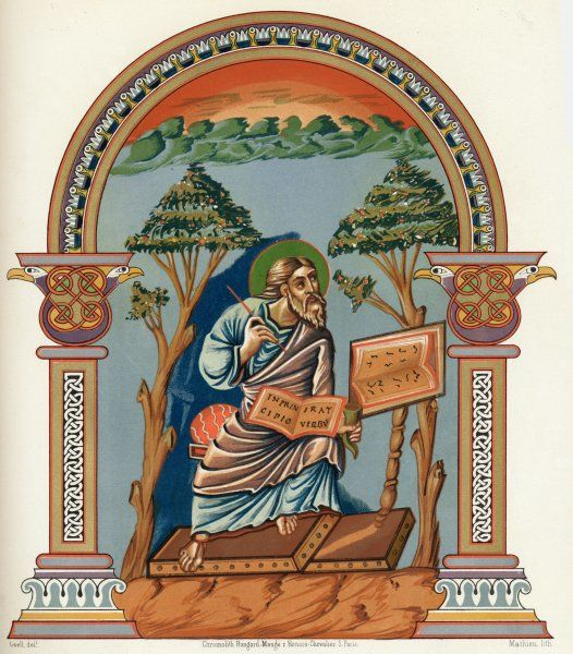 SAINT JOHN THE EVANGELIST depicted writing the first words of his gospel, 'In the beginning was the word...'