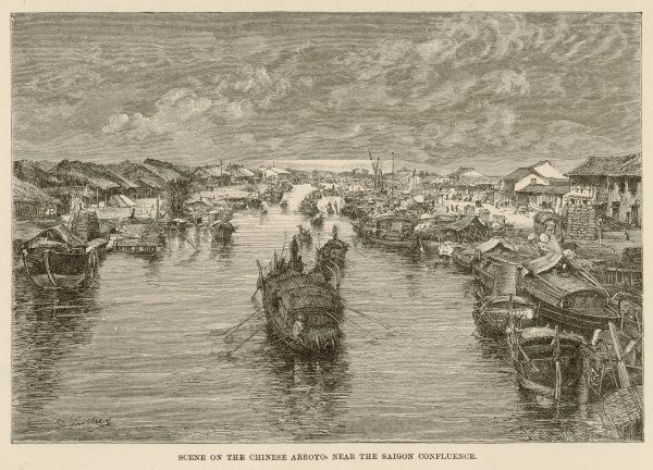 A scene with boats on the Arroyo Chinois (Chinese Arroyo), a waterway in Saigon, Vietnam