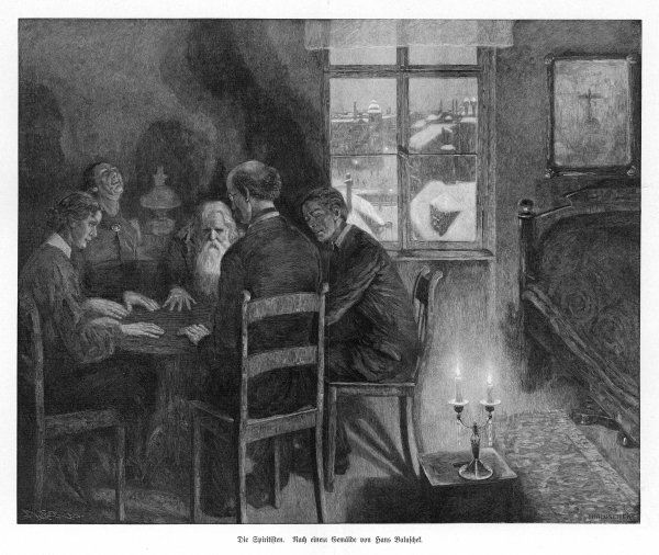 SEANCE IN A GARRET. A spirit seance in a garret on a winter evening in Germany