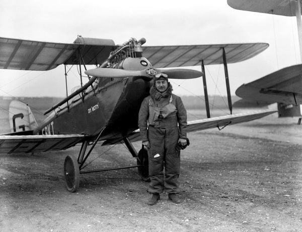 Sir Alan John Cobham ) - English aviation pioneer standing in front of his de Havilland DH.60 Moth G-EBKT, a light-weight, two-place, single-engine, single-bay British two-seat touring and training biplane aircraft. A prototype with a horn-balanced rudder