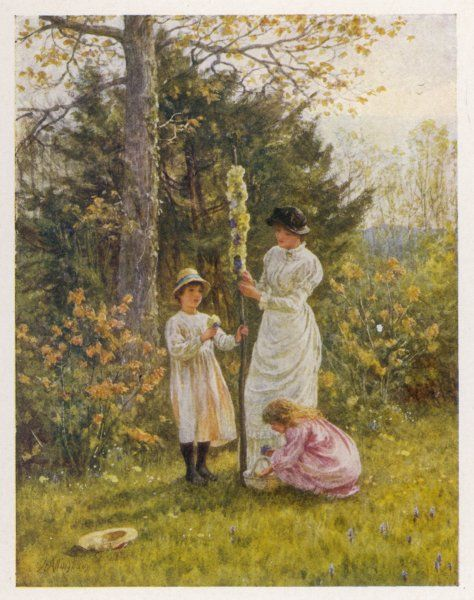 SMALL MAYPOLE. A mother helps her children deck a small, domestic maypole