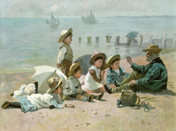 Children sitting on the beach listening to stories