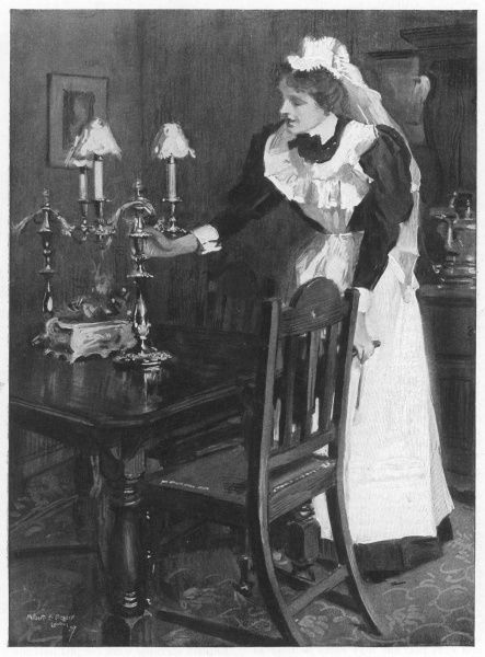 TENDING THE LAMPS. A London housemaid tends the table-lamps
