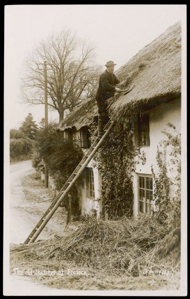 Man thatching a roof at Porlock, Somerset