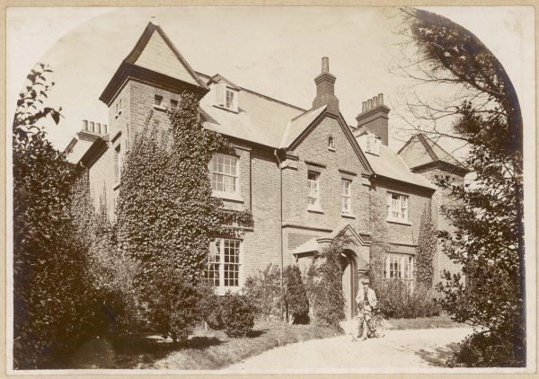 Thomas Hardy, English novelist and poet, outside his home at Max Gate in Dorchester, Dorset. Hardy designed the house, and his brother built it -- Hardy and his first wife Emma moved there in 1885