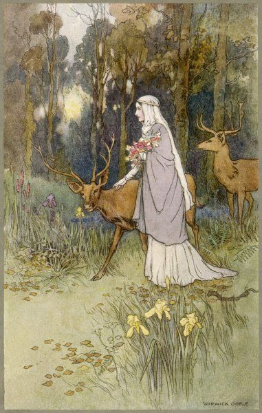 A woman walking through the woods with a timid dun deer
