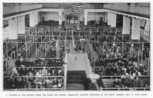 Immigrants waiting inspection in the Great Assembly Hall at Ellis Island, New York