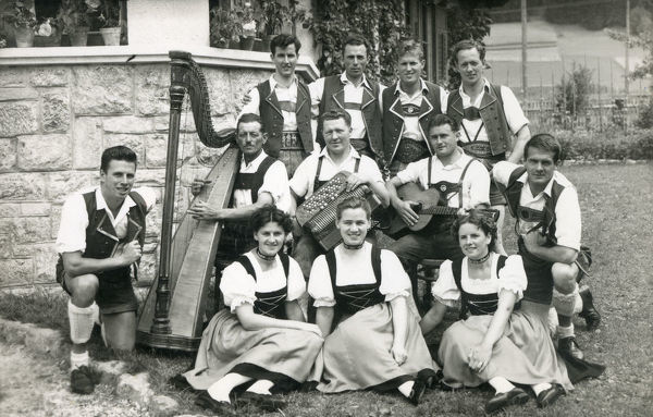 Tyrolean Austrian Musicians and Singers. The band features a Harpist, an accordion player and a Guitarist. Date: circa 1950s