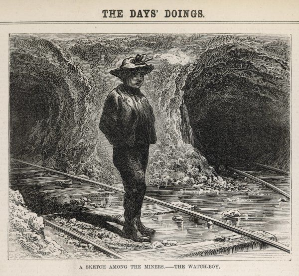 Watch boy standing at the entrance to a mine