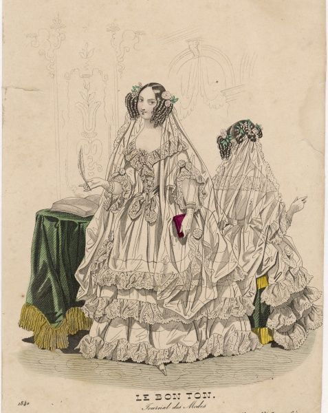 A young bride about to sign the register wears a dress with 3 lace edged flounces, pointed waist, bell shaped upper sleeves worn over a tightfitting under sleeve